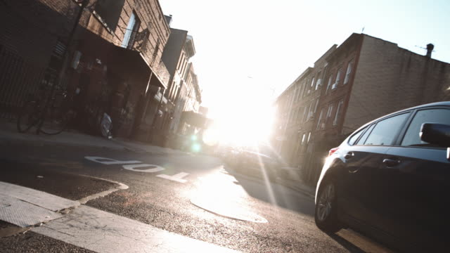 wide angle shot of a quiet block in brooklyn at sunrise - stationary stock videos & royalty-free footage