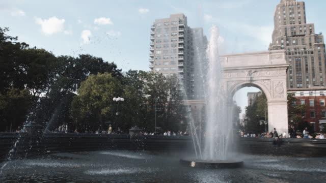 wide angle shot of new york city's washington square park - washington square park stock videos and b-roll footage