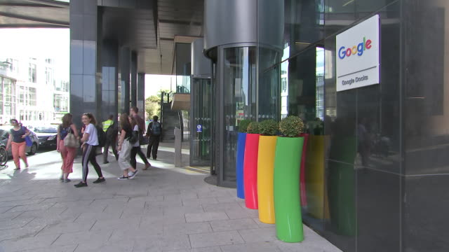 wide angle shot of pedestrians walking by the google office building in dublin, ireland on august 23, 2018. - wide angle stock videos & royalty-free footage