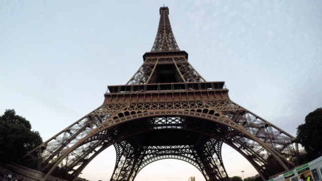 a wide angle shot of the eiffel tower from below. - eiffel tower stock videos and b-roll footage