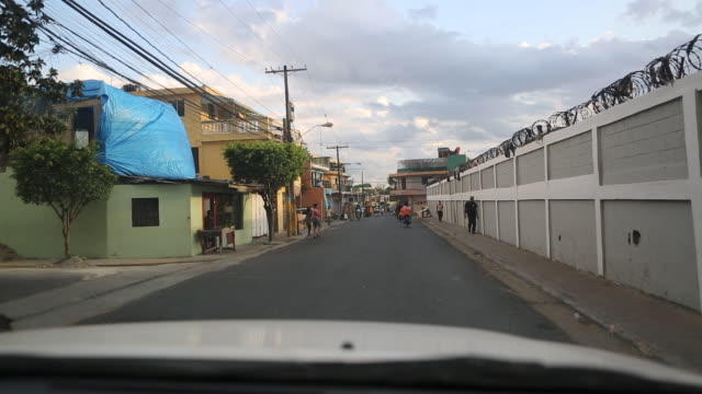 santa domingo dominican republic december 4 2012 a wide angle shot out of a windscreen of a moving car that is driving along a narrow alley and is... - santo domingo dominican republic stock videos & royalty-free footage