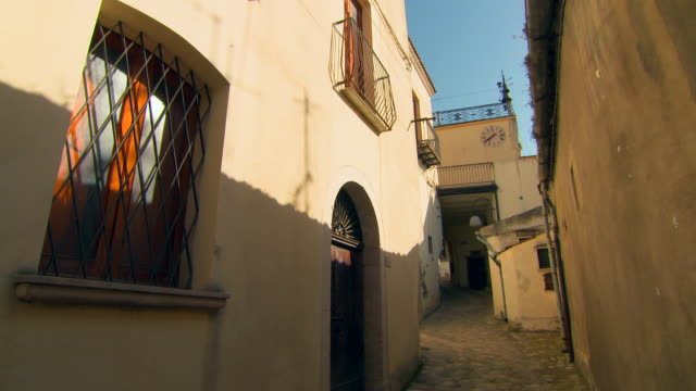 wide angle: side of building in narrow walkway - iron bars for windows stock videos & royalty-free footage