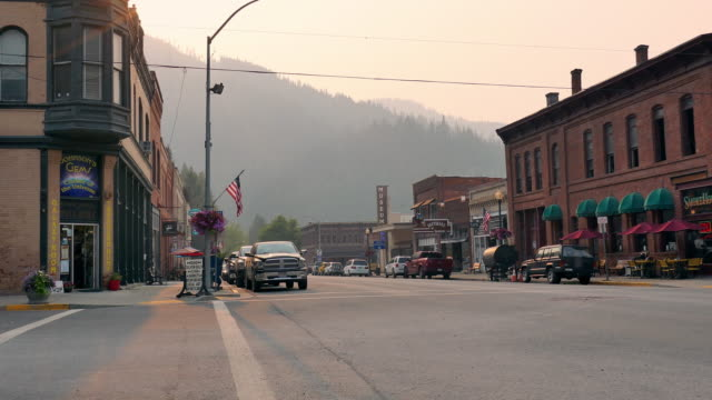 wide angle: small town below the mountains - western usa stock videos & royalty-free footage