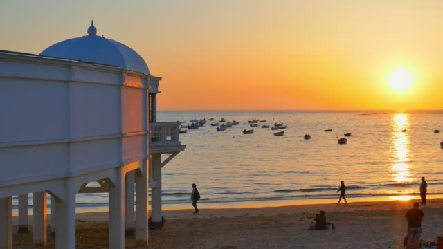 wide angle: structure on a beach with bright sun - andalucia stock videos & royalty-free footage
