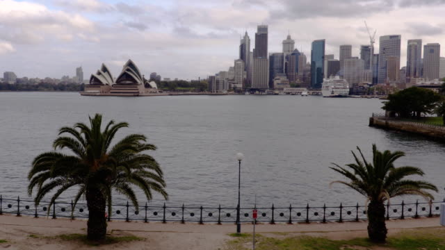 wide angle sydney city and opera house on a cloudy day - steve munro stock videos & royalty-free footage