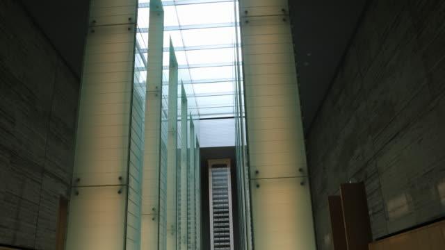 wide angle tilt up at the atomic bomb museum nagasaki the national peace memorial hall for the atomic bomb victims - massförstörelsevapen bildbanksvideor och videomaterial från bakom kulisserna