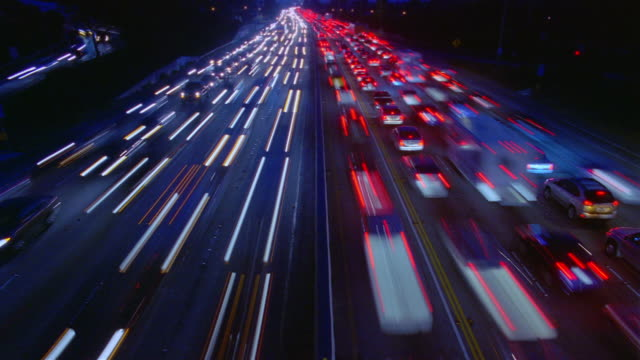Wide angle traffic moving in both directions on 405 Freeway / Los Angeles, California