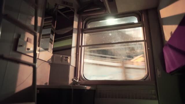 vidéos et rushes de wide angle: various lights shine through a train window while it travels - fenêtre