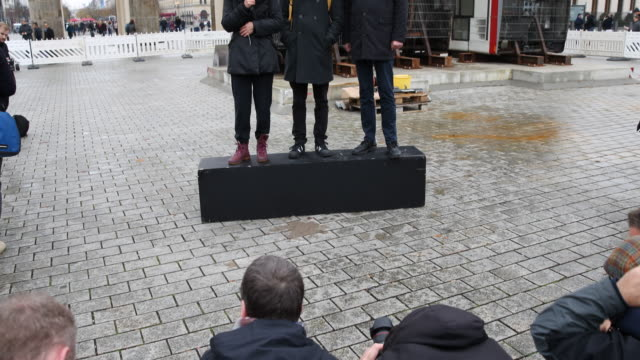Wide angle view and tilt up statement of Shermin Langhoff Intendant of the Maxim Gorky Theater in context of the installation press photographers can...