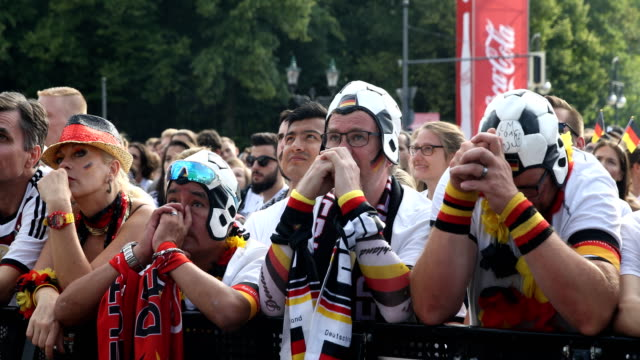 wide angle view of german fans who are getting upset after germany lost the 2018 fifa world cup russia group f match against korea republic at the... - football team stock videos & royalty-free footage
