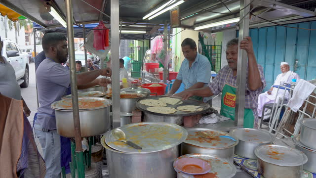 wide angle view of indian's food stall in malaysia - malaysia stock videos & royalty-free footage