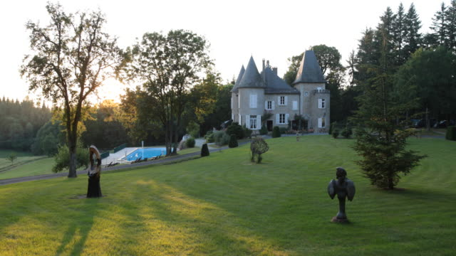 Wide angle view of the Domaine de Mialaret in Neuvic at the massif Central France at sunset A castle from the 19th century in the middle of beautiful...
