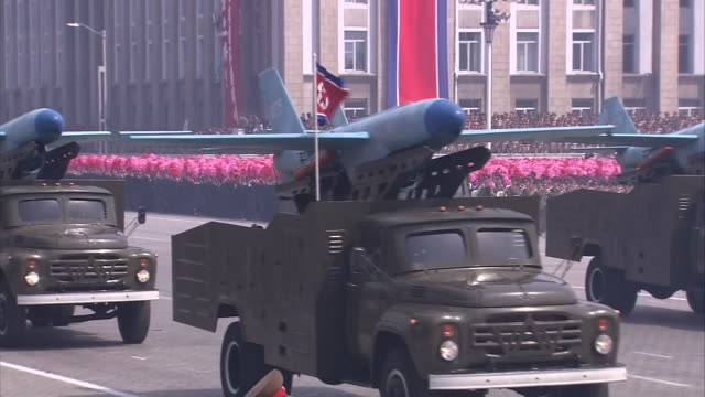 wide angle view of the north korean military parade zooming in on the unmanned aerial vehicles displayed at the parade - military parade stock videos & royalty-free footage