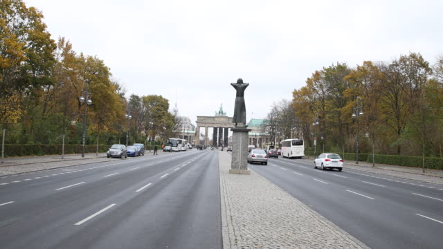Wide angle view of the'Monument' Installation in the background the Brandenburg Gate can be seen in the foreground the sculpture 'Der Rufer' from the...
