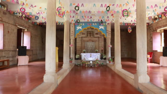 stockvideo's en b-roll-footage met wide angle view to the altar and tabernacle inside a catholic church founded by jesuits the church is built in a typical hindu temple style around... - missiehuis