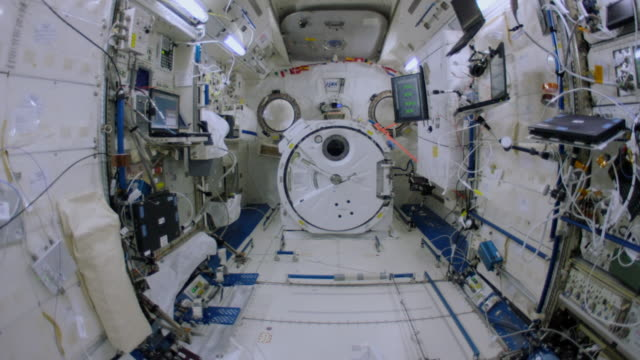 wide angle walkthrough of most parts of the spaceship which is the fruit of the international cooperation for space exploration. this video is part... - inside of stock-videos und b-roll-filmmaterial