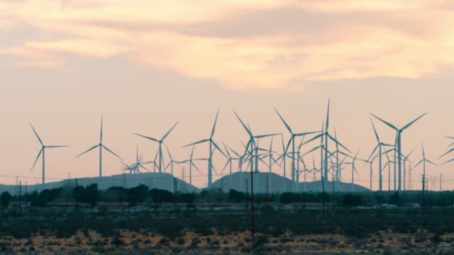 wide angle: wind turbines moving  (shot on red) - mill stock videos & royalty-free footage