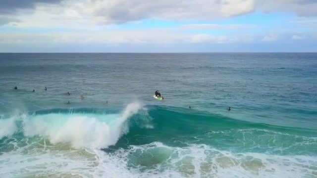 a wide blue ocean at pipeline, hawaii & one surfer catching a wave - wide stock videos & royalty-free footage
