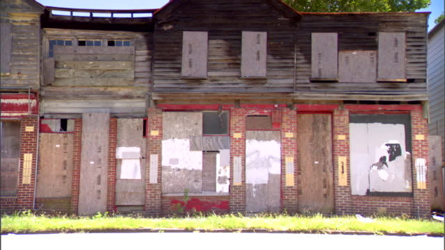 ws wide building in severe state of disrepair boarded windows doors low income poverty - south america stock videos & royalty-free footage