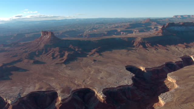 a wide canyon separates the desert in canyonland national park. - canyonlands national park stock videos & royalty-free footage