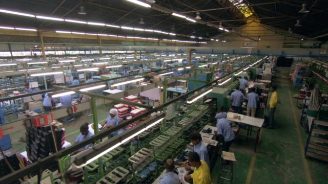 wide crane shots in a shoe-making factory - ethiopia stock videos & royalty-free footage