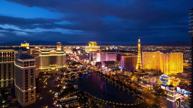 vidéos et rushes de wide day to night view of the las vegas strip from above - jour