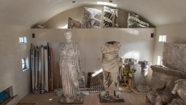 Wide dolly shot of various Greek Statues