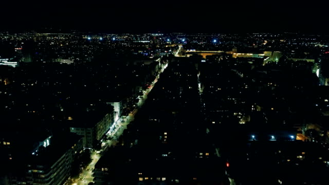 Wide drone shot flying over the city of Sofia, Bulgaria at night