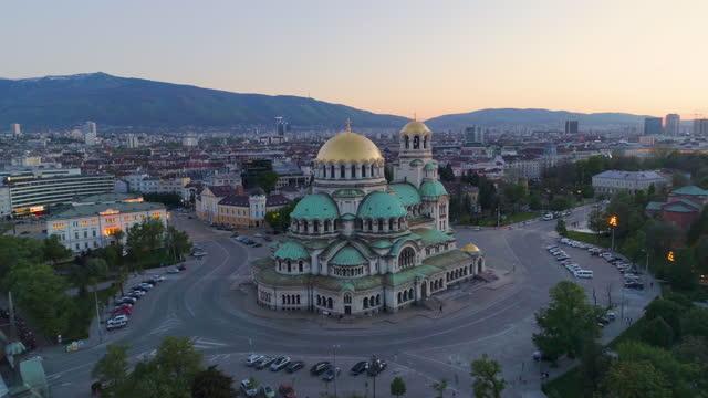 wide drone shot of st. alexander nevski cathedral in sofia, bulgaria at sunset,(bulgarian: катедрала свети александър невски, софия, българия), forward, dolly shot - bulgaria stock videos & royalty-free footage