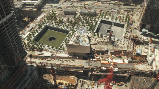 wide, elevated shot of the national september 11 memorial & museum whilst under construction during the summer of 2011, manhattan, new york city, usa. - anno 2001 video stock e b–roll