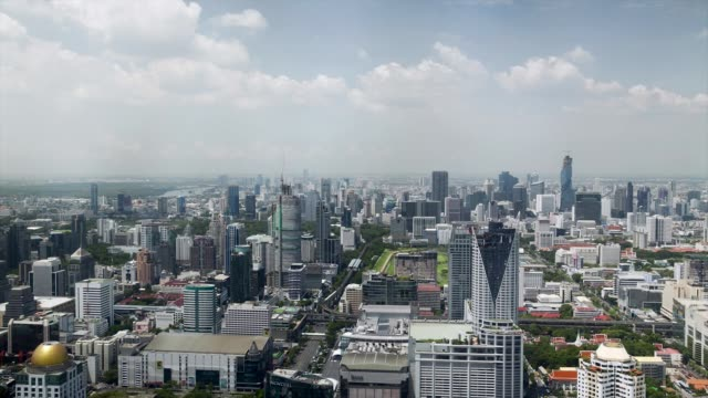 wide elevated shot timelapse pan left to right of commercial and residential buildings in the sathorn district of bangkok thailand on friday july 24... - bangkok stock-videos und b-roll-filmmaterial