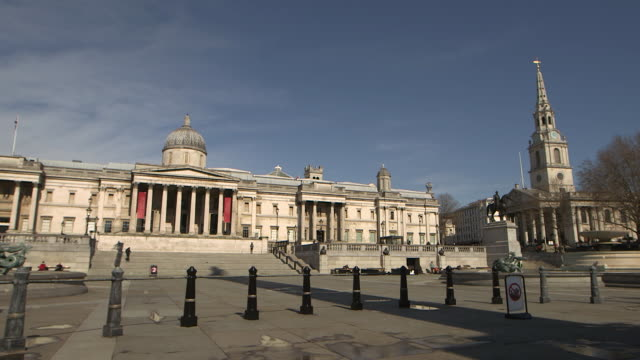 wide establishing shot of a nearly empty trafalgar square during the covid-19 pandemic in london. - healthcare and medicine or illness or food and drink or fitness or exercise or wellbeing stock videos & royalty-free footage