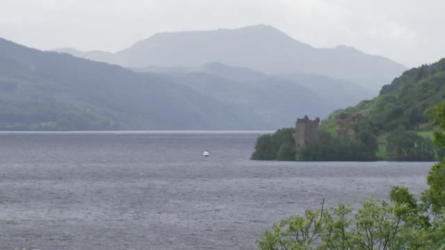 wide establishing shot of loch ness and grant tower in scotland, united kingdom. - environment or natural disaster or climate change or earthquake or hurricane or extreme weather or oil spill or volcano or tornado or flooding stock videos & royalty-free footage