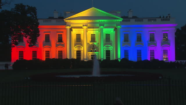 wide establishing shot of the white house exterior lit up in rainbow colors after the supreme courtõs decision to legalize same-sex marriage across... - 2015 stock videos & royalty-free footage