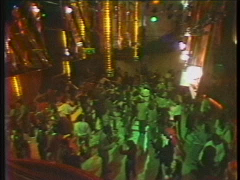 wide establishing shots of people dancing inside the famed nightclub, studio 54 in new york city in 1978. - nightclub stock videos & royalty-free footage