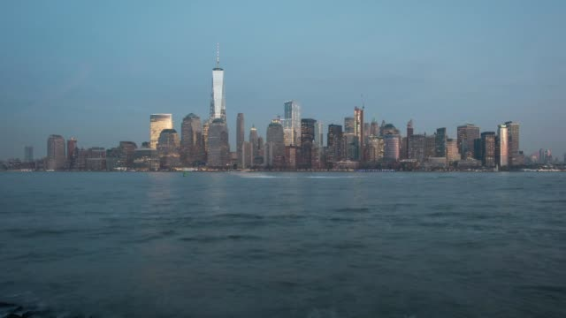 Wide exterior time lapse shots of the downtown New York City skyline from the shores of New Jersey US on December 30th 2015 Photographer Ron...