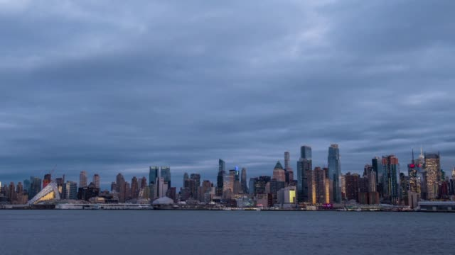Wide exterior time lapse shots of the downtown New York City skyline from New Jersey in New York City US on December 30th 2015 Photographer Ron...
