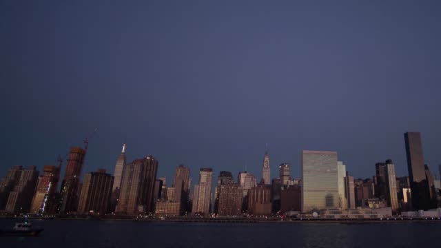 Wide exterior time lapse shots of the downtown New York City skyline from Queens in New York City US on December 30th 2015 Photographer Craig Warga...