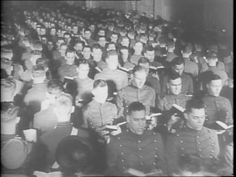 wide exterior view of west point chapel in new york / view of chapel behind trees / west point cadets marching to the front of the crowded chapel / a... - cadet stock videos & royalty-free footage