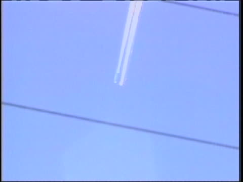 wide faraway tracking shot of the sky as apparently two objects fall through the sky followed by long white streams of smoke the objects themselves... - four objects stock videos & royalty-free footage