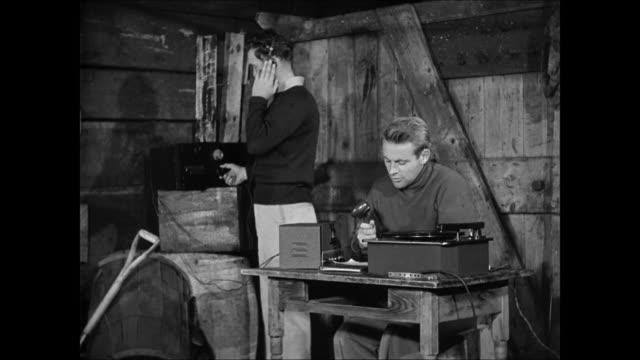 wide farmland, barn house int radio station, norwegians secretly broadcasting voice operator int vs norwegian men listening to radio in their homes . - hiding stock videos & royalty-free footage