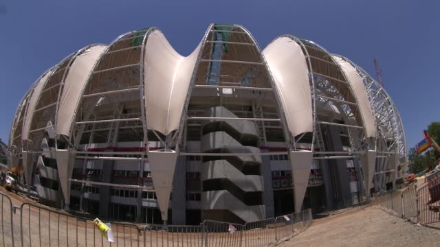 wide fisheye lens shot construction at estadio beirario in porto alegre continues home to the sport club internacional one of brazil's biggest clubs... - porto alegre stock-videos und b-roll-filmmaterial