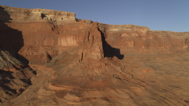 wide flyover view of brown mountain range / lake powell, utah, united states - lake powell stock videos & royalty-free footage