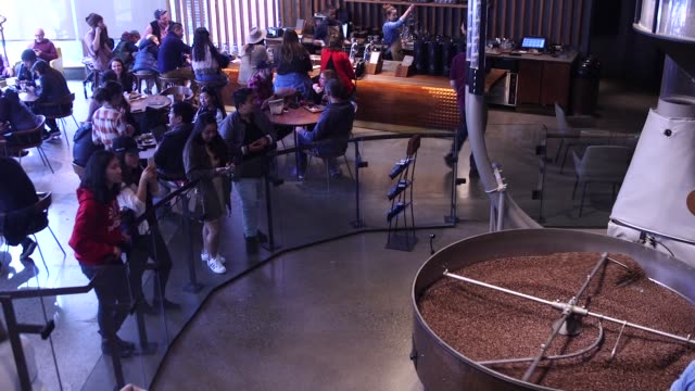 wide footage of coffee beans stirring and being roasted at the starbucks reserve roastery and tasting room in seattle wa on october 9 2017... - スターバックス点の映像素材/bロール