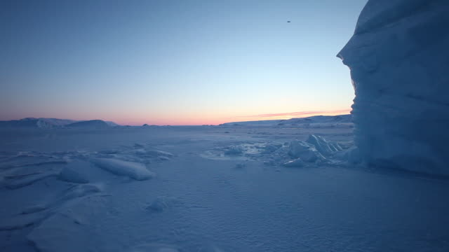 wide, frozen tundra in greenland at sunset - greenland stock videos & royalty-free footage