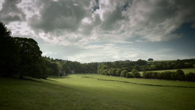 Wide green valley in the cotswold hills