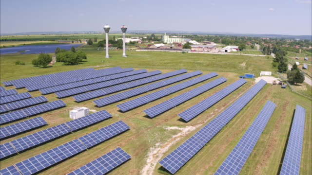 Wide high angle aerial shot of solar panels in field / Aleksandrovo, Lovech Province, Bulgaria
