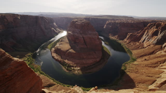 wide high angle flyover shot of river bend in canyon / page, arizona, united states - river bend land feature stock videos & royalty-free footage