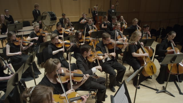 wide high angle shot of high school orchestra performing on stage / salt lake city, utah, united states - orchestra stock videos & royalty-free footage