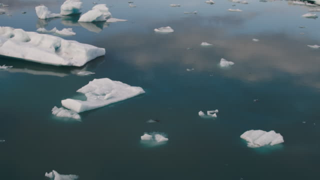 Wide high angle shot of ice floating in lagoon / Iceland